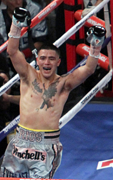 Brandon Rios celebrates his win vs. John Murray for the WBA lightweight title. (AP)