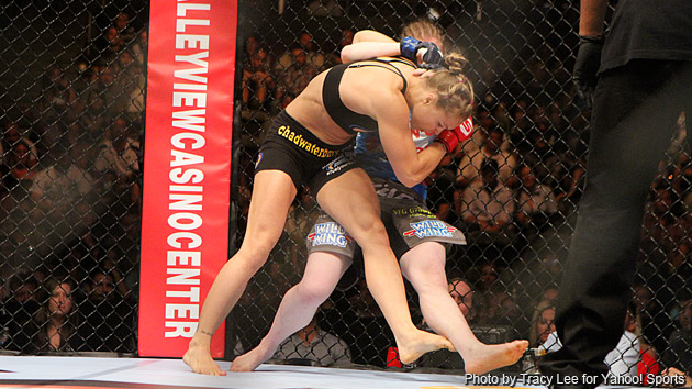 Ronda Rousey's dominance harkens back to Mike Tyson in his prime. (Tracy Lee for Y! Sports)