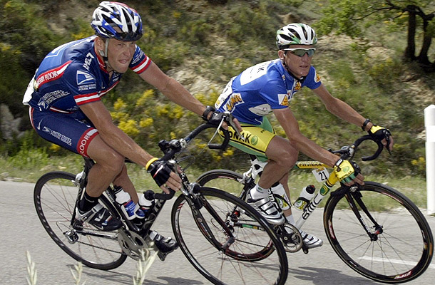Lance Armstrong and Tyler Hamilton ride together in 2004. (Getty Images)
