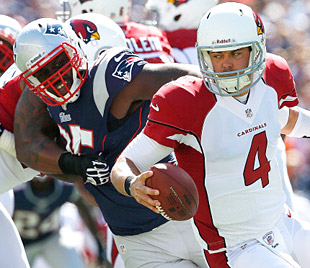 The Patriots' Chandler Jones pressures Arizona QB Kevin Kolb. (Getty Images)