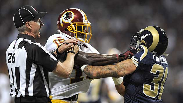 Josh Morgan (C) mixes it up with Cortland Finnegan in the first half. (US Presswire)