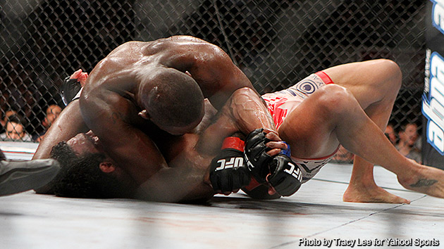 Jon Jones submits Vitor Belfort with an Americana in the fourth round on Saturday. (Courtesy Tracy Lee for Y! Sports)