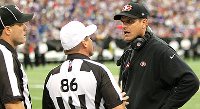 Jim Harbaugh works his magic on official Ken Roan (No. 86) on Sunday. (US Presswire)