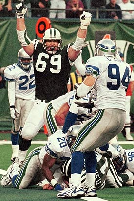 Vinny Testaverde is surrounded by a number of Seahawks during the controversial '98 game. (AP)