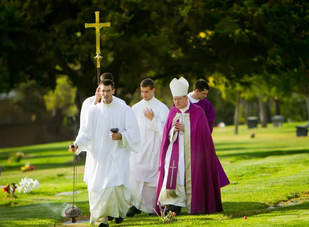 Frater Matthew (formerly Grant) Desme (L) participates in a ceremony on All Souls' Day. (Rick Belcher/St. Michael's Abbey)