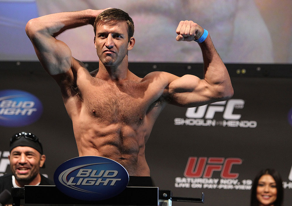 Stephan Bonnar flexes for the crowd during a weigh-in. (Getty)