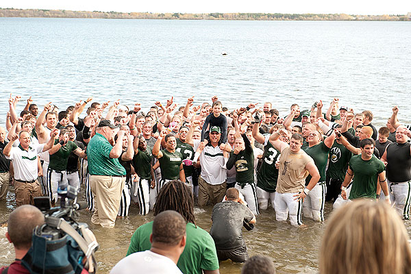 Bemidji State players and coaches celebrate by jumping into Lake Bemidji. (BSU Athletic Media Relations)