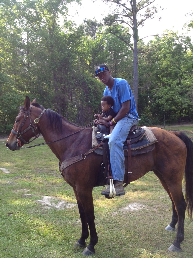 Johnthan Banks didn't waste time putting his son atop a horse. (Courtesy of Mississippi State)