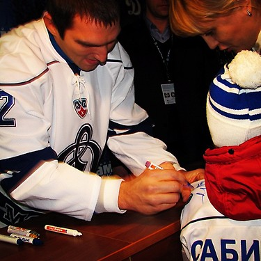 Alex Ovechkin was swamped by autograph seekers during the intermission of a Dynamo Moscow game. (Y! Sports)