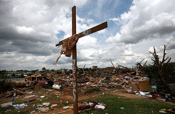 A cross stands over a destroyed neighborhood in Tuscaloosa. (Getty Images)