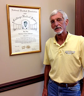 Ray Guy's poses next to his College Football Hall of Fame certificate. (Yahoo! Sports)