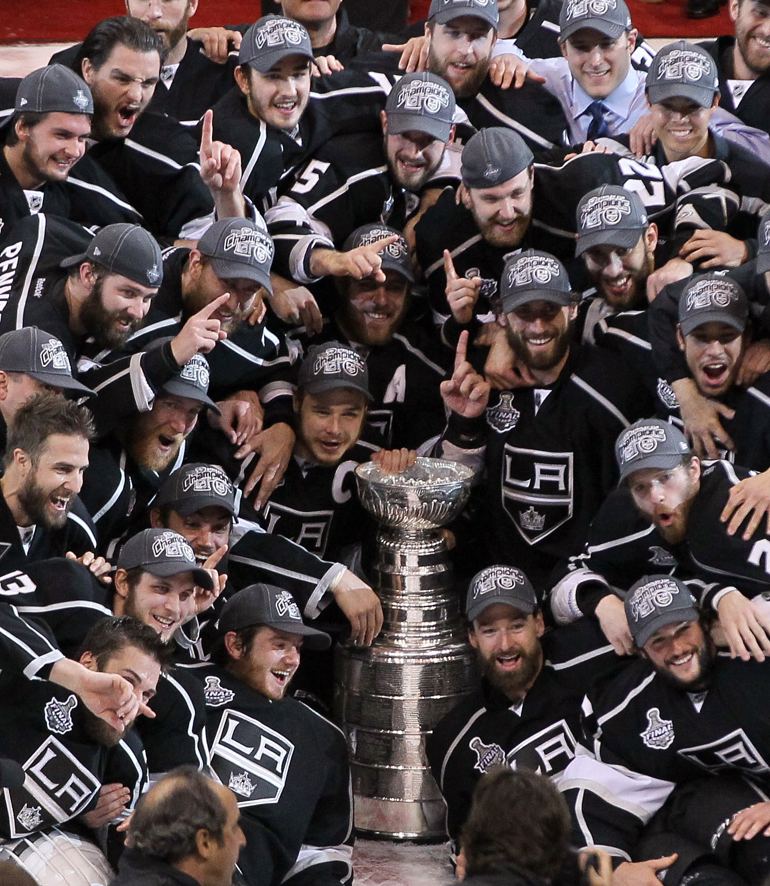 Sixteen teams skate into the NHL playoffs, all hoping to take a group photo at the end. (Getty)