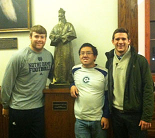 Notre Dame defensive lineman Grant Patton, left, and students Alvin Hu and Colin King. (Notre Dame)