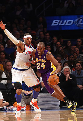 Kobe Bryant leads the NBA in scoring while Carmelo Anthony ranks second. (Getty Images)