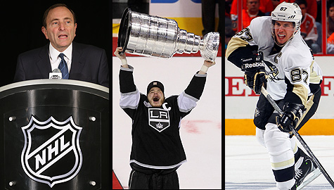 NHL commissioner Gary Bettman, Los Angeles Kings captain Dustin Brown with the Stanley Cup, and Pittsburgh Penguins captain Sidney Crosby