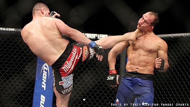 Cain velasquez kicks junior dos santos in the face courtesy tracy