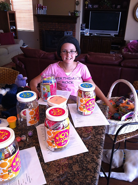 Jessie Rees prepares JoyJars to take to sick children in the hospital. (Jessie Rees Foundation)