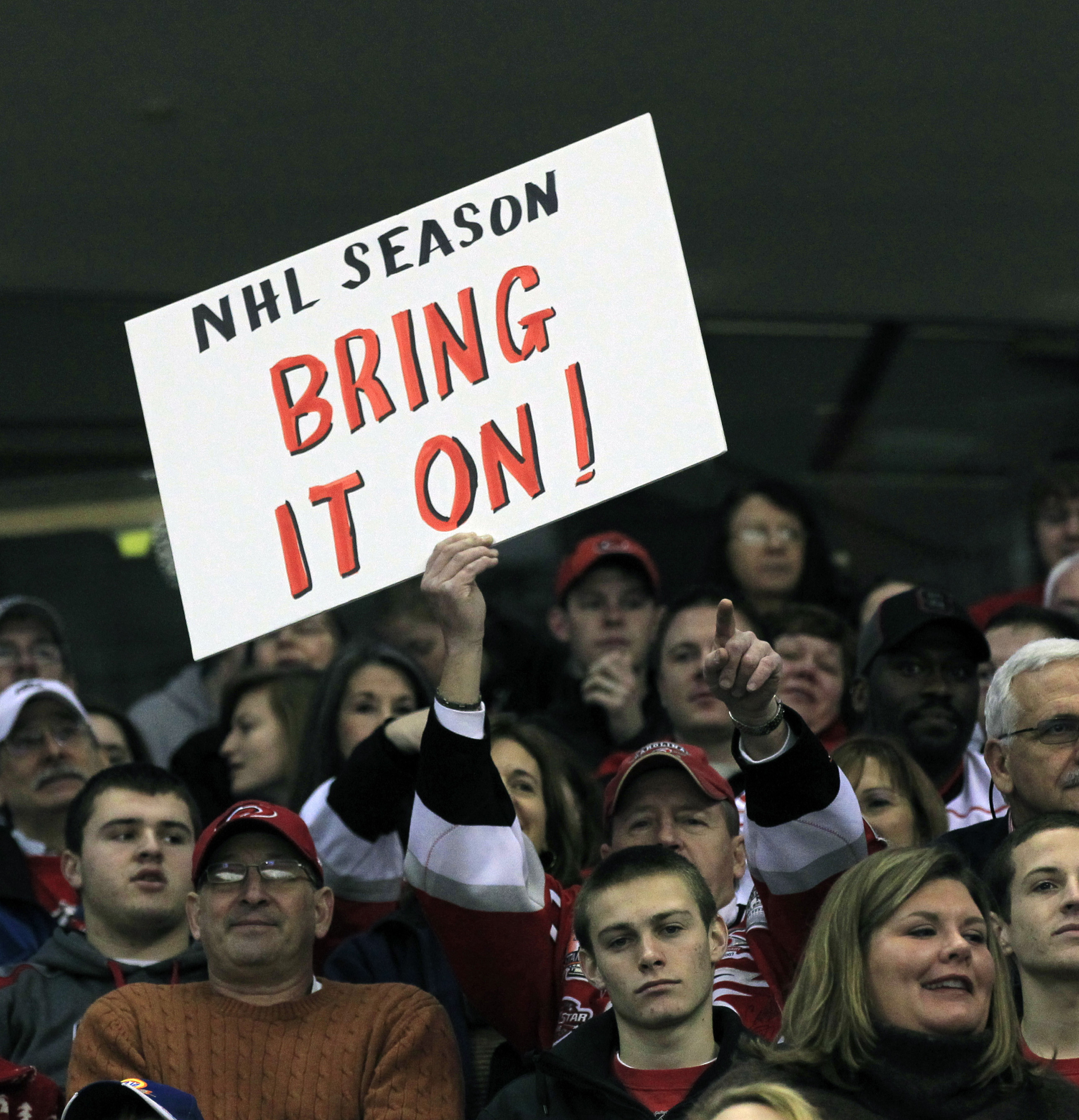 NHL fan holds up his sign voicing his opinion on the lockout. (Chris Seward/Raleigh News & Observer/MCT via Getty Images)