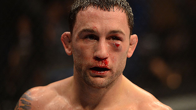 The wear and tear of a five-round fight shows on the face of Frankie Edgar. (Getty)