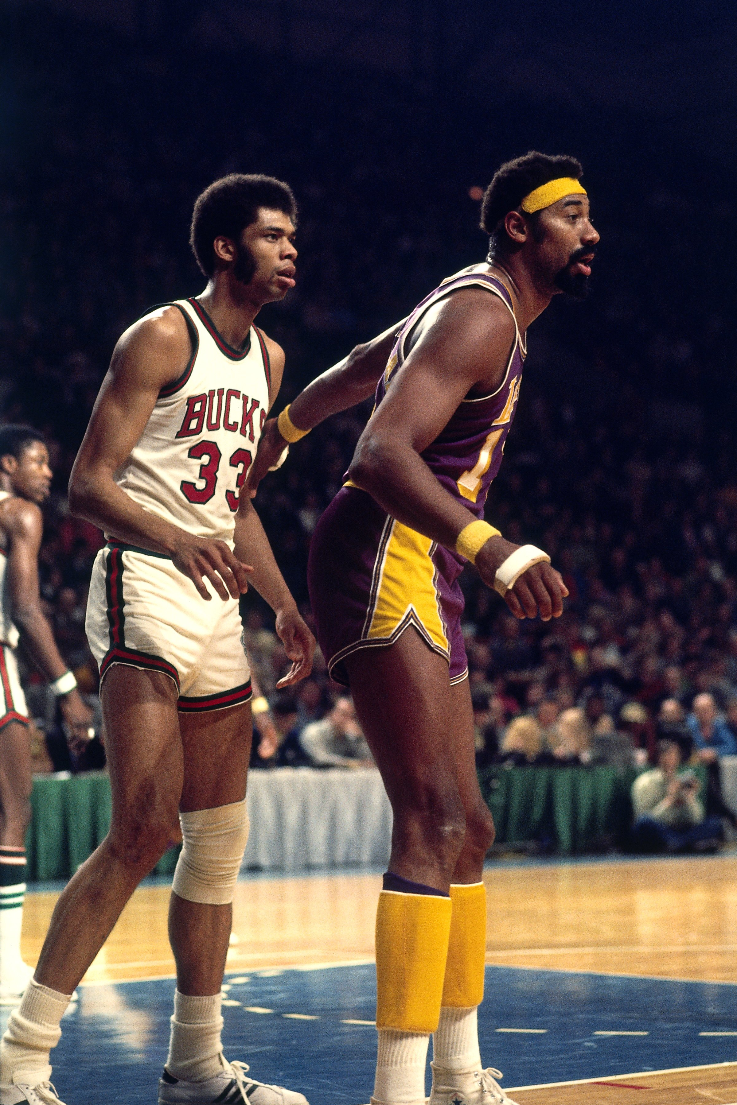 Wilt Chamberlain posts up against Kareem Abdul-Jabbar (33) in 1972. (Getty)