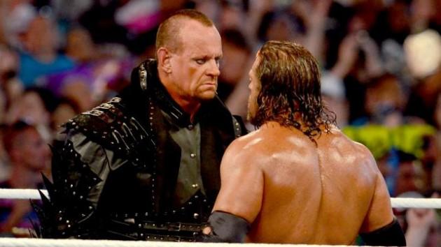 هل المصارع أندرتيكر أصلع ؟ ومتى سيكشف ذلك؟ WrestleMania-28-Undertaker-Triple-H-630x354-jpg_203240