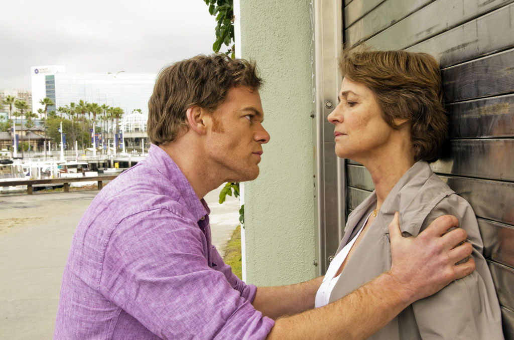 "Michael C. Hall as Dexter Morgan and Charlotte Rampling as Dr. Vogel on ""Dexter."""