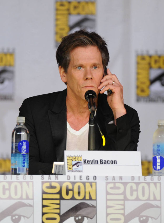 "Kevin Bacon takes a call during ""The Following"" panel on Friday, July 19 during San Diego Comic-Con 2013."