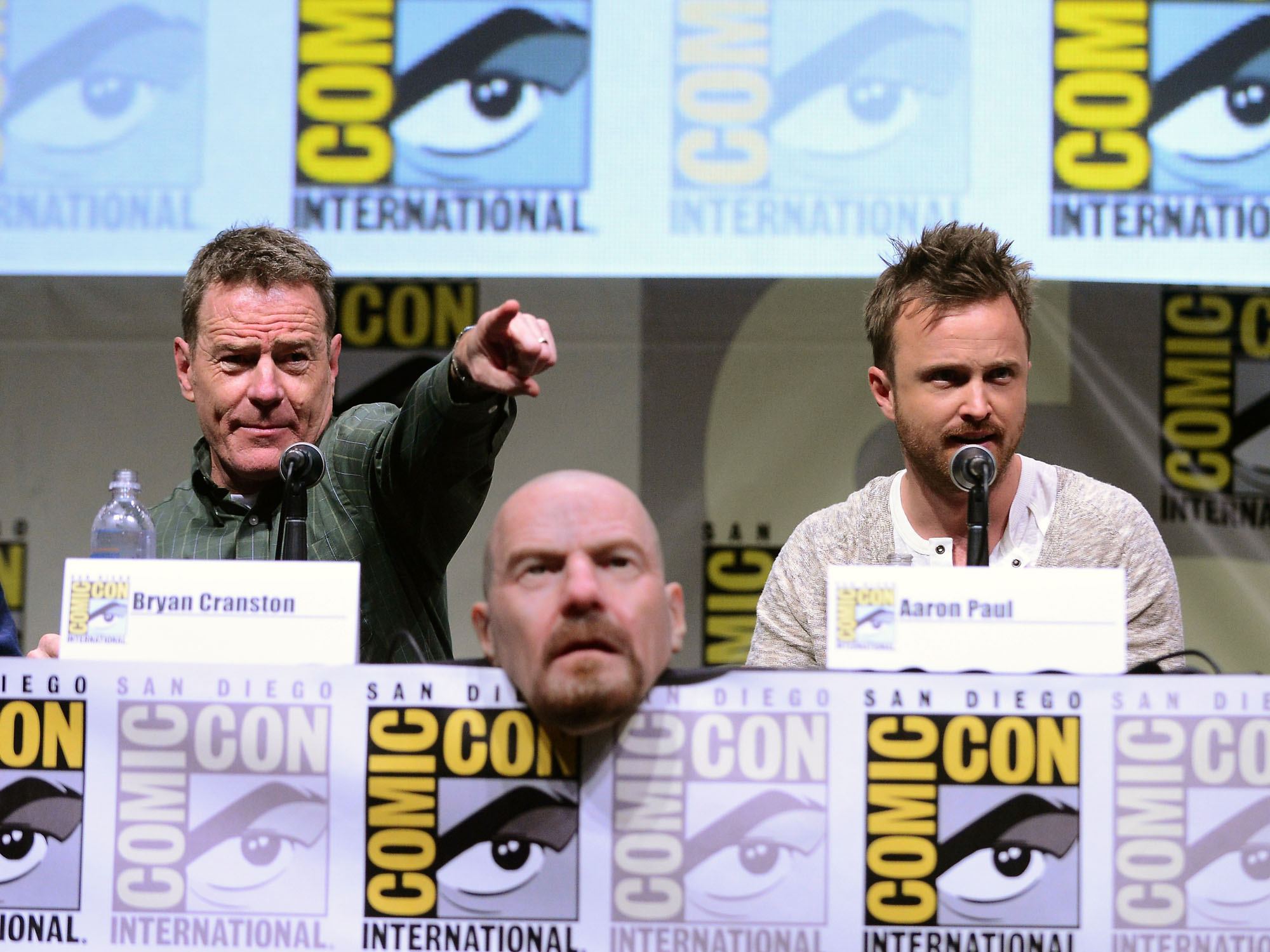 "Bryan Cranston and Aaron Paul speak onstage at the ""Breaking Bad"" panel during Comic-Con International 2013 at San Diego Convention Center on July 21, 2013 in San Diego, California."