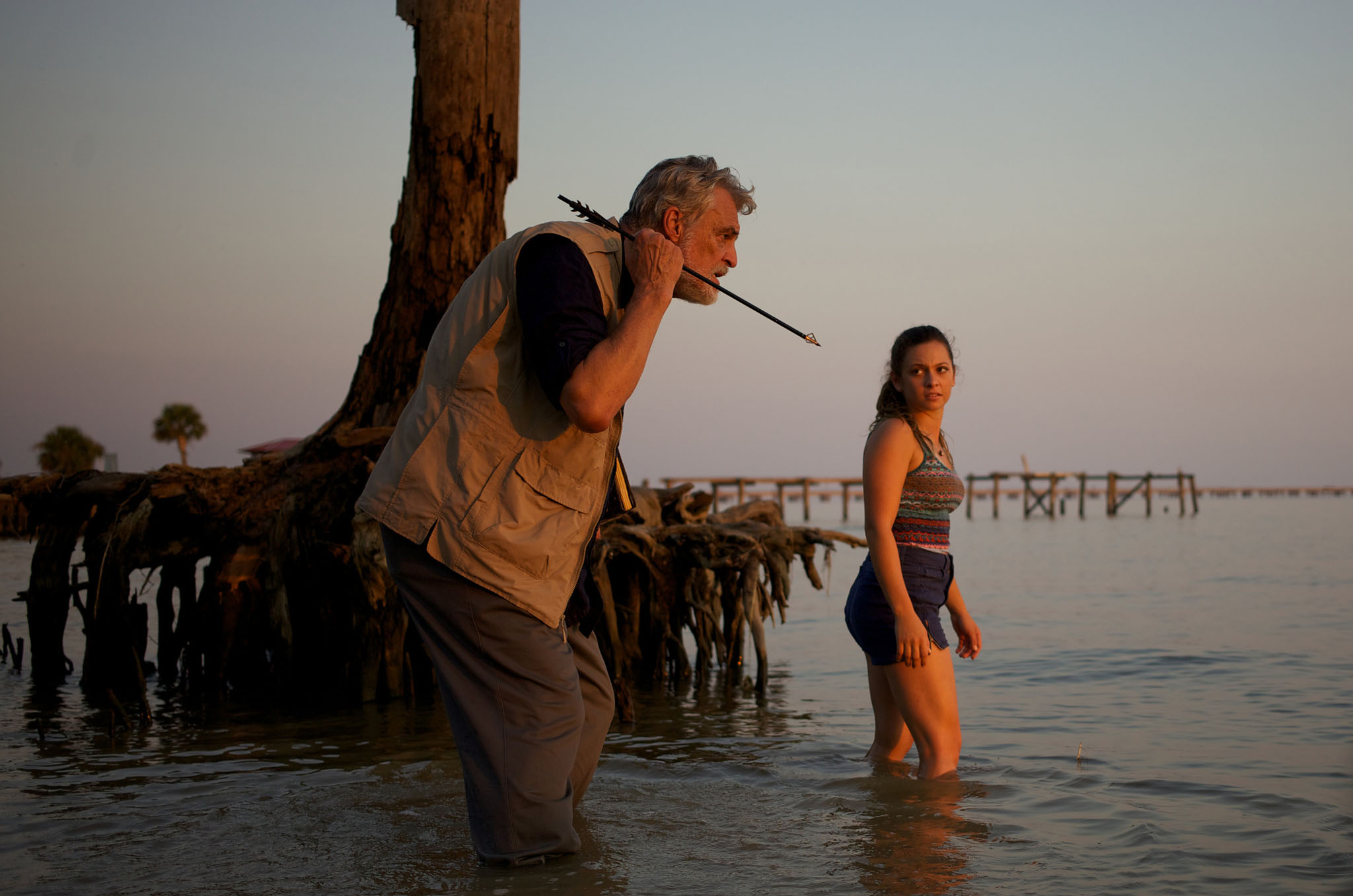 "Richard Moll as Finch and Mackenzie Rosman as Ava in ""Ghost Shark."""