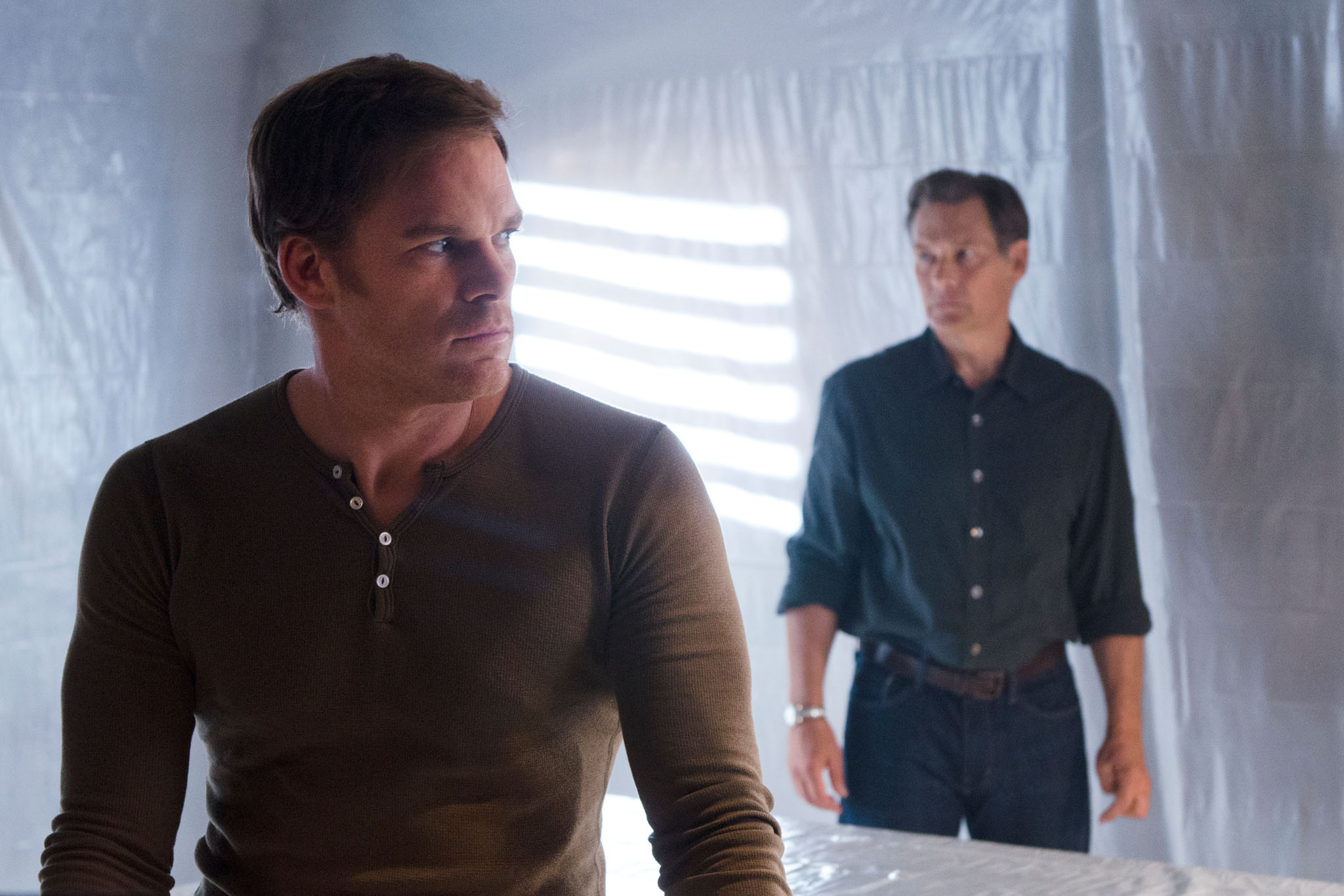 Michael C. Hall as Dexter Morgan and James Remar as Harry Morgan in the 'Dexter' Season 8 episode, 'Goodbye Miami.'