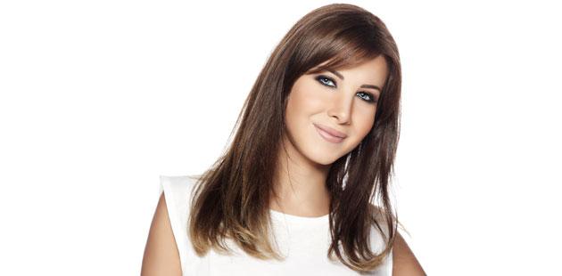 تعرف كيفية تعاملت نانسي عجرم مشتركين ايدول الموسم الثاني Arab Nancy-Ajram-Intervie