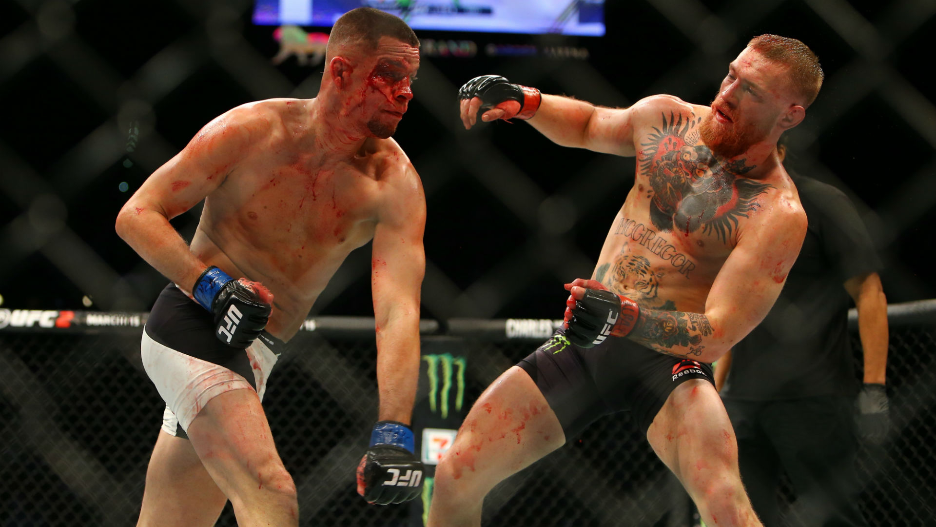 Nate Diaz lands a punch on Conor McGregor during their UFC 196 fight. (Getty)