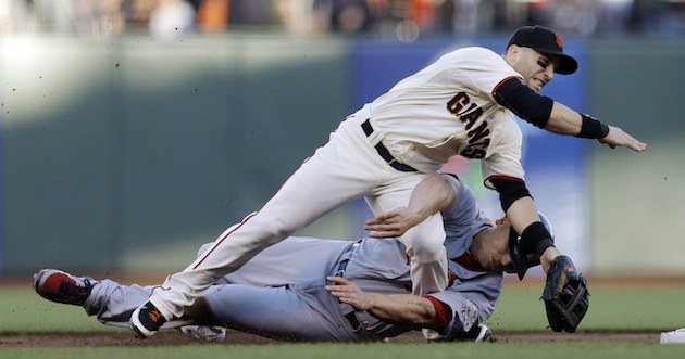 Slide fires up Giants, leads to early Scutaro exit
