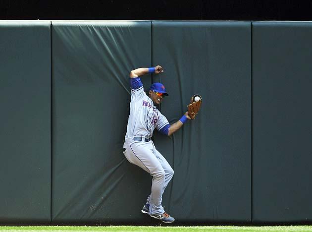 Mets' Juan Lagares makes great catch slamming into Target Field…