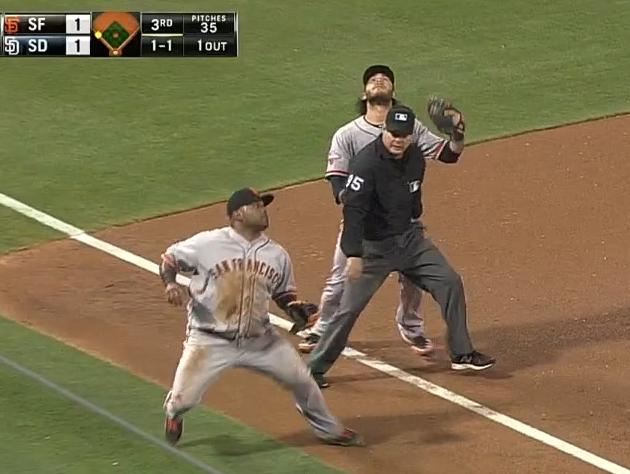 Umpire Tim Timmons interferes with Brandon Crawford on infield …