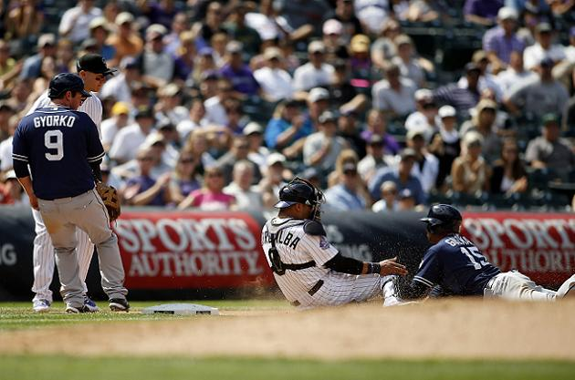 Rockies catcher Yorvit Torrealba tags out two runners on one pl…