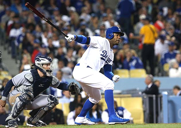 Carl Crawford wears one blue shoe and one white shoe in Jackie …