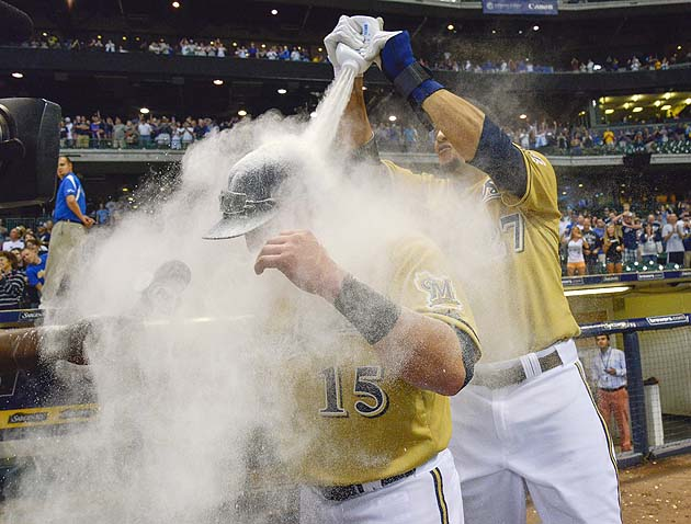 Photo: Carlos Gomez delouses Caleb Gindl