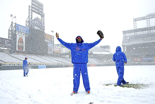 Snow blankets Coors Field, postpones Rockies-Mets game until Tu…