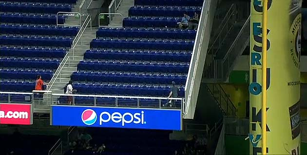 Ten reasons two fans at Marlins Park sit oddly still for Anthon…