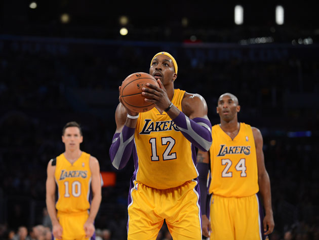 Dwight Howard attempts to fix his free throw woes by lining up …