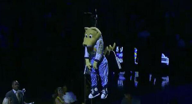 An unconscious Denver Nuggets mascot is lowered to the arena fl…