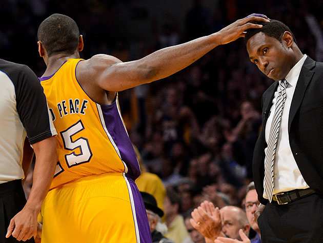 Metta World Peace rubs Avery Johnson's head after nailing a 3 d…