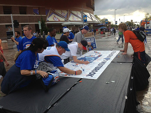 Thunder fans sign 'get well soon' card for injured Russell West…