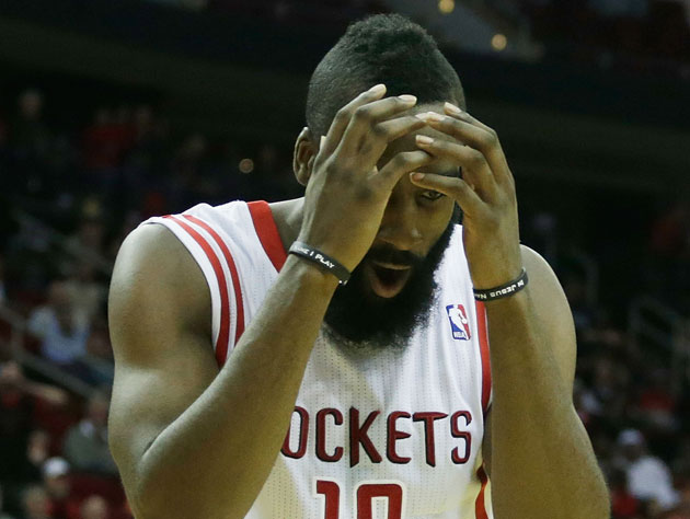 James Harden high fives some imaginary teammates after a made f…