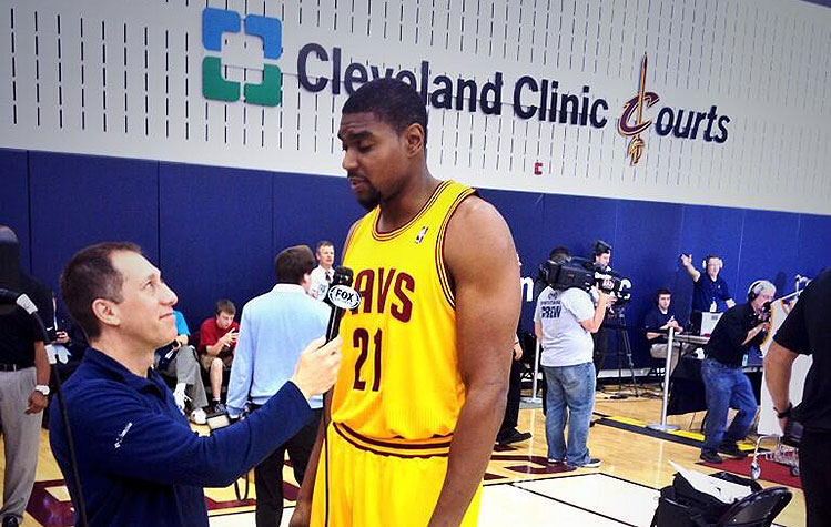 You guys, Andrew Bynum cut his hair