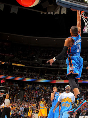 Russell Westbrook blocks the Denver Nuggets mascot's halfcourt …