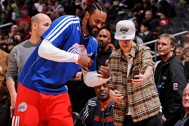 Create-a-Caption: Ronny Turiaf represents the spoils of fame