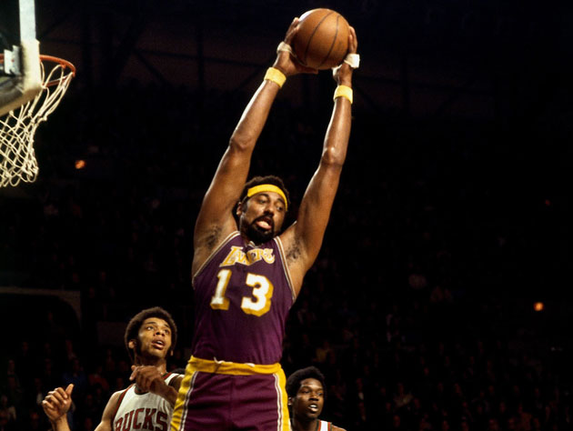 Watch Wilt Chamberlain swat shots an arm's length above the rim…