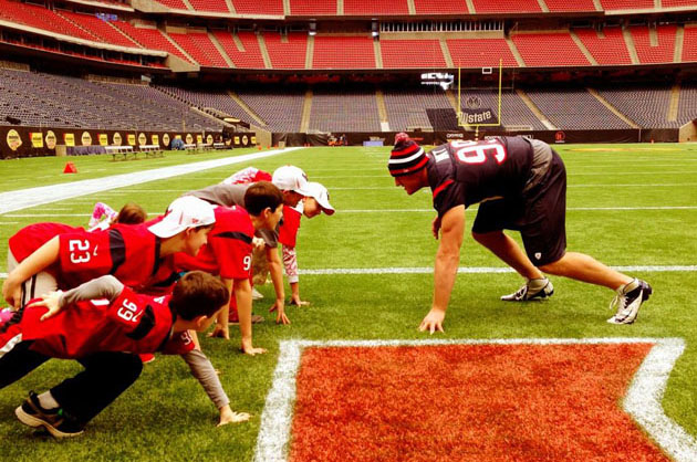 J.J. Watt lines up against kids from Newtown